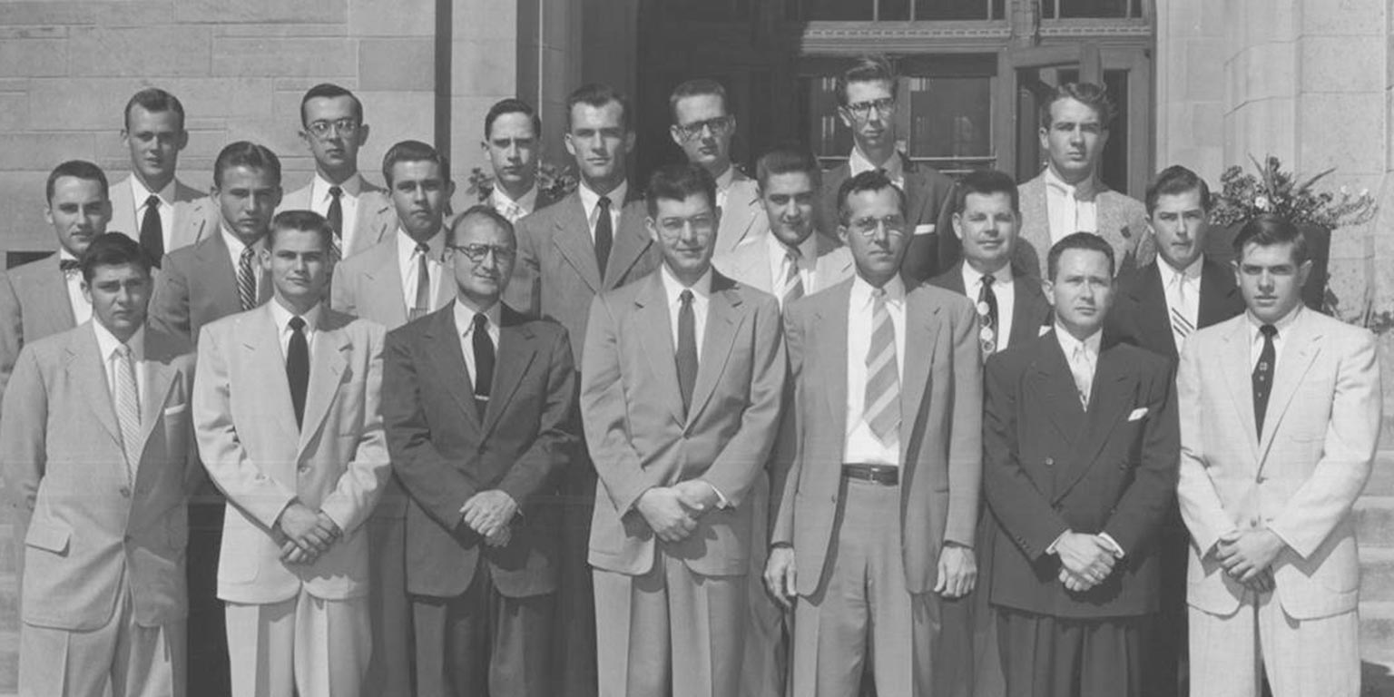 IU School of Optometry Class of 1956. Twenty men wearing suits and ties.