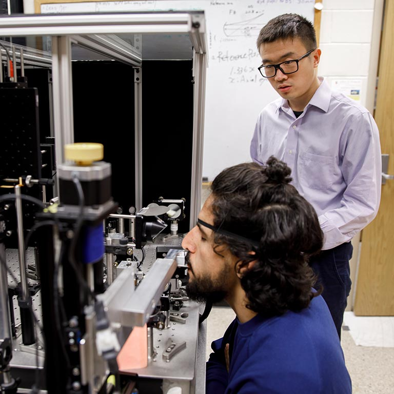 Two optometry students perform research in the Miller Lab.